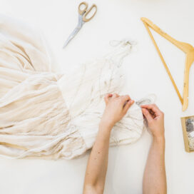overhead-view-fashion-designer-s-hand-sewing-dress